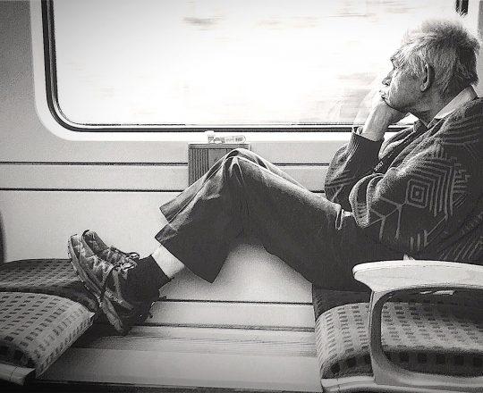 Mann im Zug-